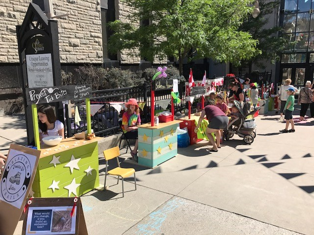 Pop-up stands with young children selling original wares